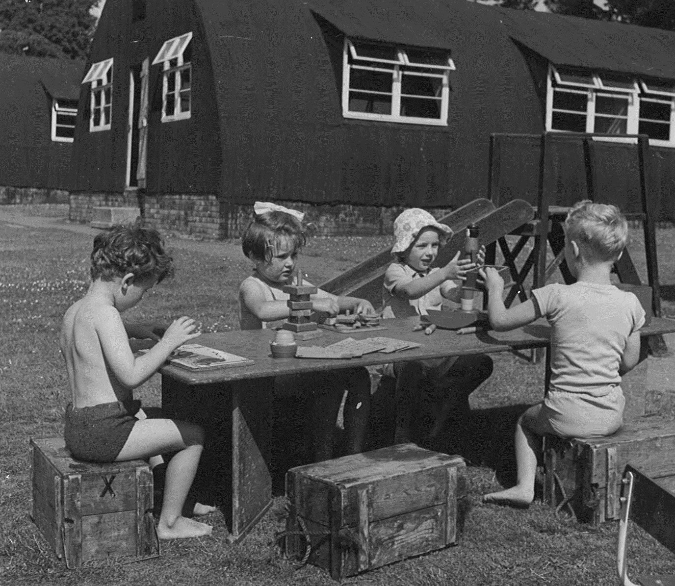 Practising school Wimbledon, circa 1950, using army Nissen huts for classrooms